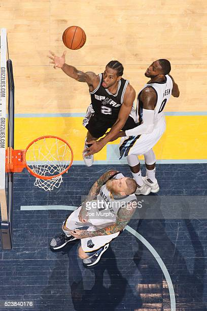 Kawhi Leonard of the San Antonio Spurs shoots a layup against the Memphis Grizzlies in Game Four of the Western Conference Quarterfinals during the...