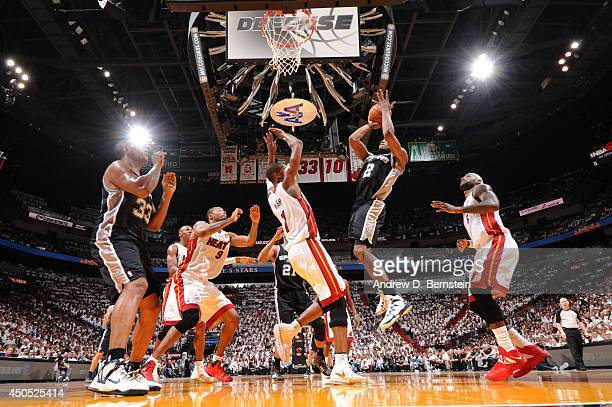 Kawhi Leonard of the San Antonio Spurs shoots against Chris Bosh of the Miami Heat during Game Four of the 2014 NBA Finals between the Miami Heat and...