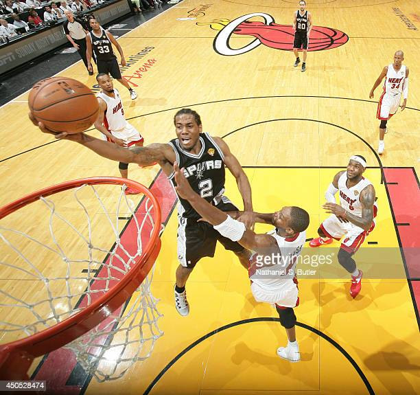 Kawhi Leonard of the San Antonio Spurs shoots against Chris Bosh of the Miami Heat during Game Four of the 2014 NBA Finals at American Airlines Arena...