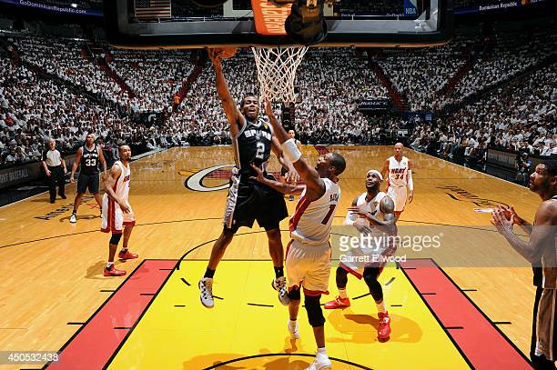 Kawhi Leonard of the San Antonio Spurs shoots against Chris Bosh of the Miami Heat in Game Four of the 2014 NBA Finals at American Airlines Arena on...