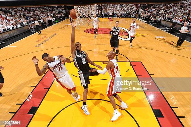 Kawhi Leonard of the San Antonio Spurs shoots against Mario Chalmers and Ray Allen of the Miami Heat during Game Four of the 2014 NBA Finals between...
