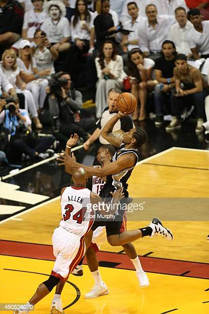 Kawhi Leonard of the San Antonio Spurs shoots against the Miami Heat during Game Four of the 2014 NBA Finals at American Airlines Arena on June 12...