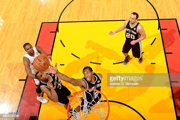 Kawhi Leonard of the San Antonio Spurs shoots during Game Four of the 2014 NBA Finals between the Miami Heat and San Antonio Spurs at the American...