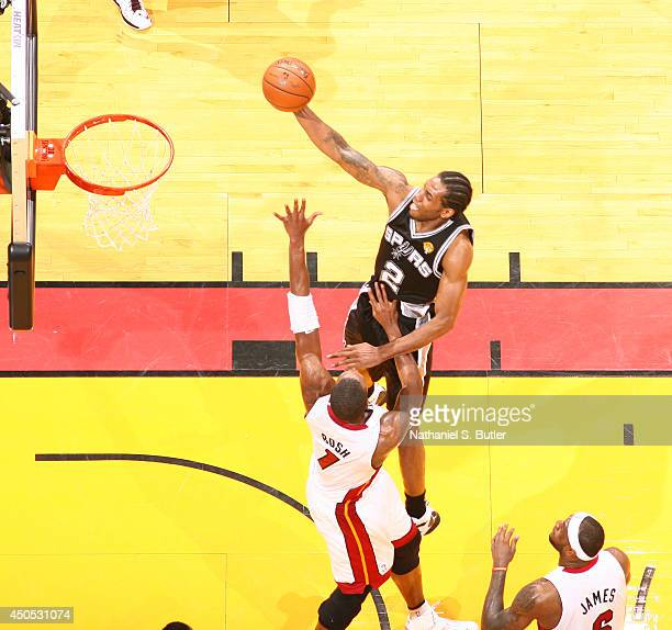 Kawhi Leonard of the San Antonio Spurs shoots over Chris Bosh of the Miami Heat during Game Four of the 2014 NBA Finals at American Airlines Arena in...