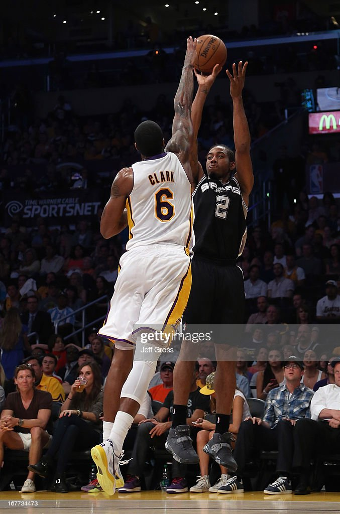 Kawhi Leonard #2 of the San Antonio Spurs shoots over Earl Clark #6 of the Los Angeles Lakers in the first half during Game Four of the Western Conference Quarterfinals of the 2013 NBA Playoffs at Staples Center on April 28, 2013 in Los Angeles, California. The Spurs defeated the Lakers 103-82.