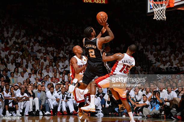Kawhi Leonard of the San Antonio Spurs shoots the ball against the Miami Heat during Game Six of the 2014 NBA Finals on June 12 2014 at American...