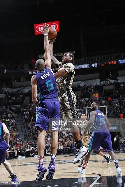 Kawhi Leonard of the San Antonio Spurs shoots the ball against the Charlotte Hornets on November 7 2015 at the ATT Center in San Antonio Texas NOTE...