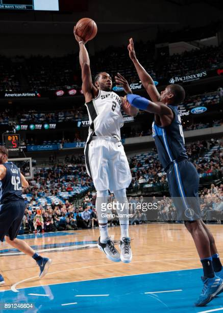 Kawhi Leonard of the San Antonio Spurs shoots the ball against the Dallas Mavericks on December 12 2017 at the American Airlines Center in Dallas...