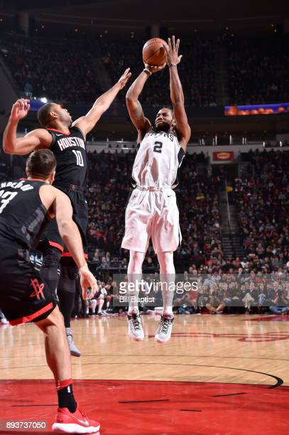 Kawhi Leonard of the San Antonio Spurs shoots the ball against the Houston Rockets on December 15 2017 at the Toyota Center in Houston Texas NOTE TO...