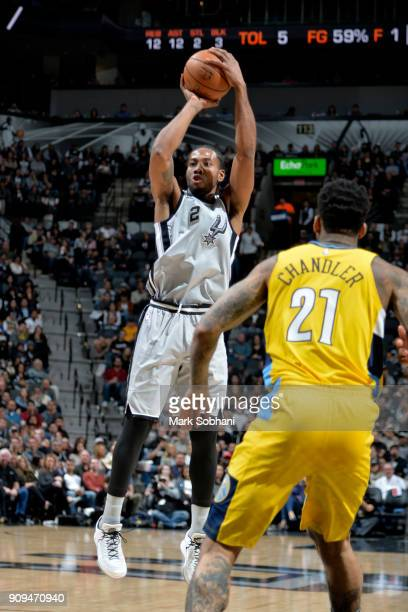 Kawhi Leonard of the San Antonio Spurs shoots the ball against the Denver Nuggets on January 13 2018 at the ATT Center in San Antonio Texas NOTE TO...