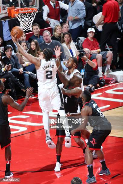 Kawhi Leonard of the San Antonio Spurs shoots the ball during the game Houston Rockets on December 15 2017 at Toyota Center in Houston Texas NOTE TO...