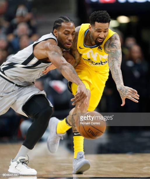 Kawhi Leonard of the San Antonio Spurs steals the back from Wilson Chandler of the Denver Nuggets at ATT Center on January 13 2018 in San Antonio...