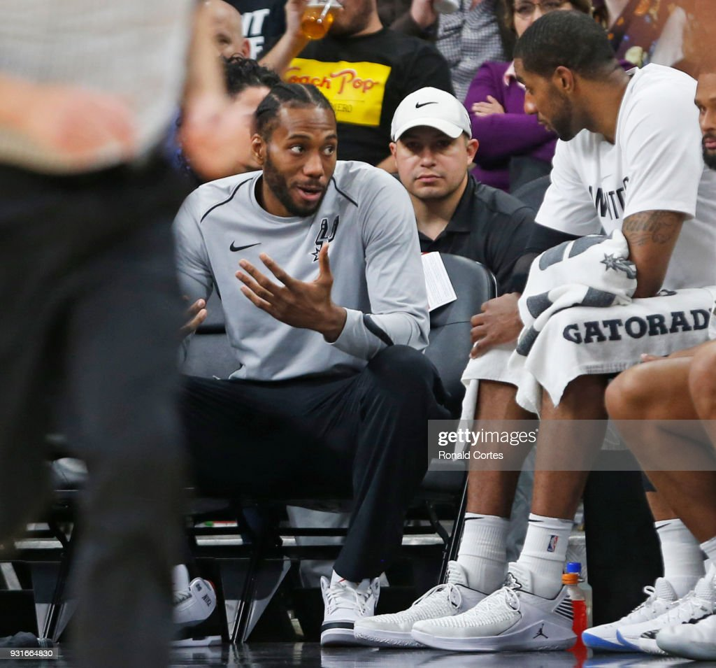 Kawhi Leonard #2 of the San Antonio Spurs still not playing talks with teammate LaMarcus Aldridge #12 of the San Antonio Spurs during game against the Orlando Magic at AT&T Center on March 13, 2018 in San Antonio, Texas.