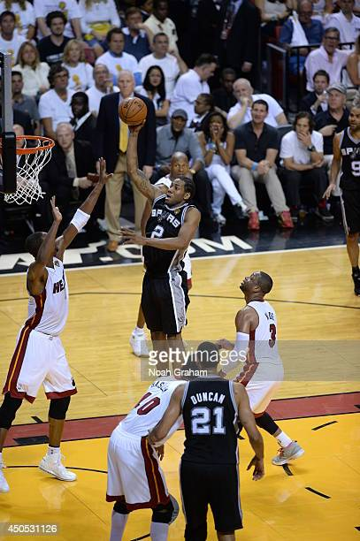 Kawhi Leonard of the San Antonio Spurs takes a shot against the Miami Heat during Game Four of the 2014 NBA Finals at American Airlines Arena on June...
