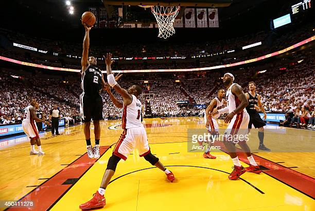 Kawhi Leonard of the San Antonio Spurs takes a shot over Chris Bosh of the Miami Heat during Game Three of the 2014 NBA Finals at American Airlines...