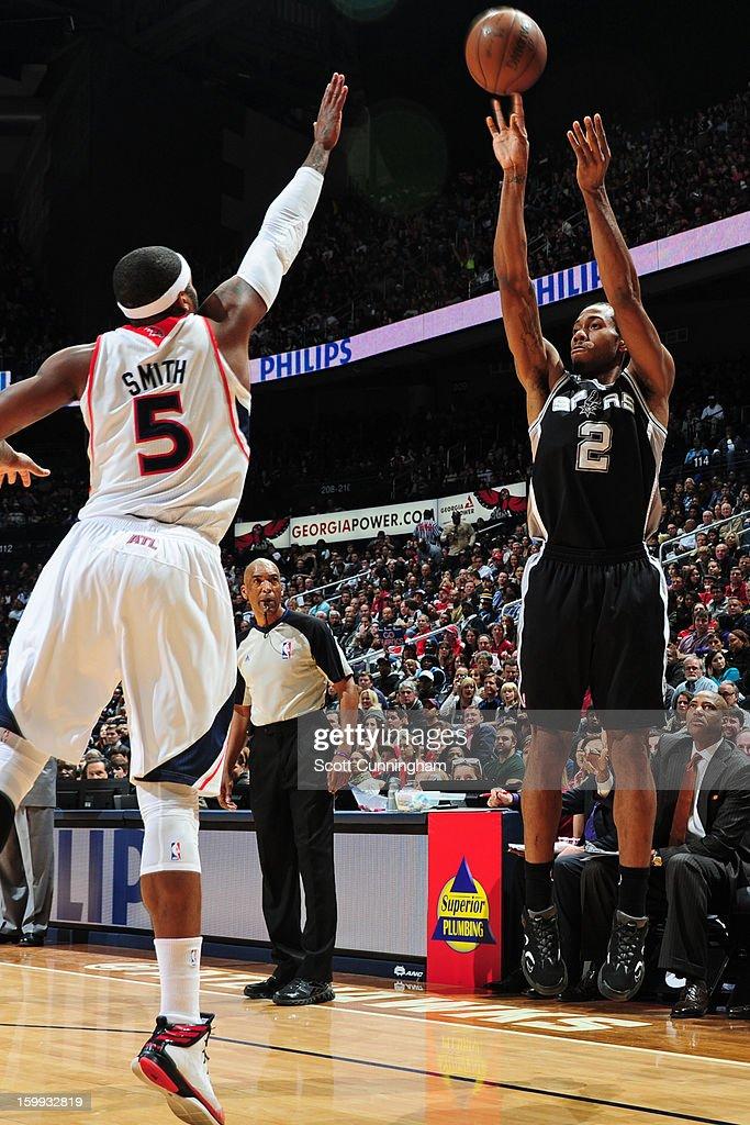 Kawhi Leonard #2 of the San Antonio Spurs takes a shot over Josh Smith #5 of the Atlanta Hawks on January 19, 2013 at Philips Arena in Atlanta, Georgia.