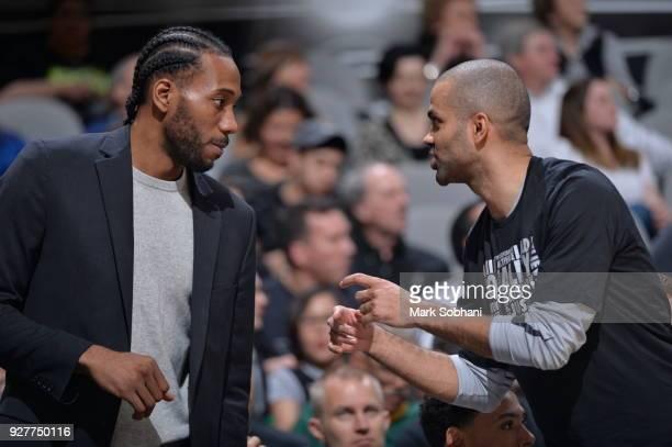 Kawhi Leonard of the San Antonio Spurs talks with Tony Parker of the San Antonio Spurs during the game against the New Orleans Pelicans on February...