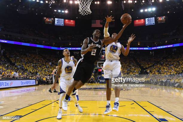 Kawhi Leonard of the San Antonio Spurs throws up a shot against the Golden State Warriors during Game One of the NBA Western Conference Finals at...