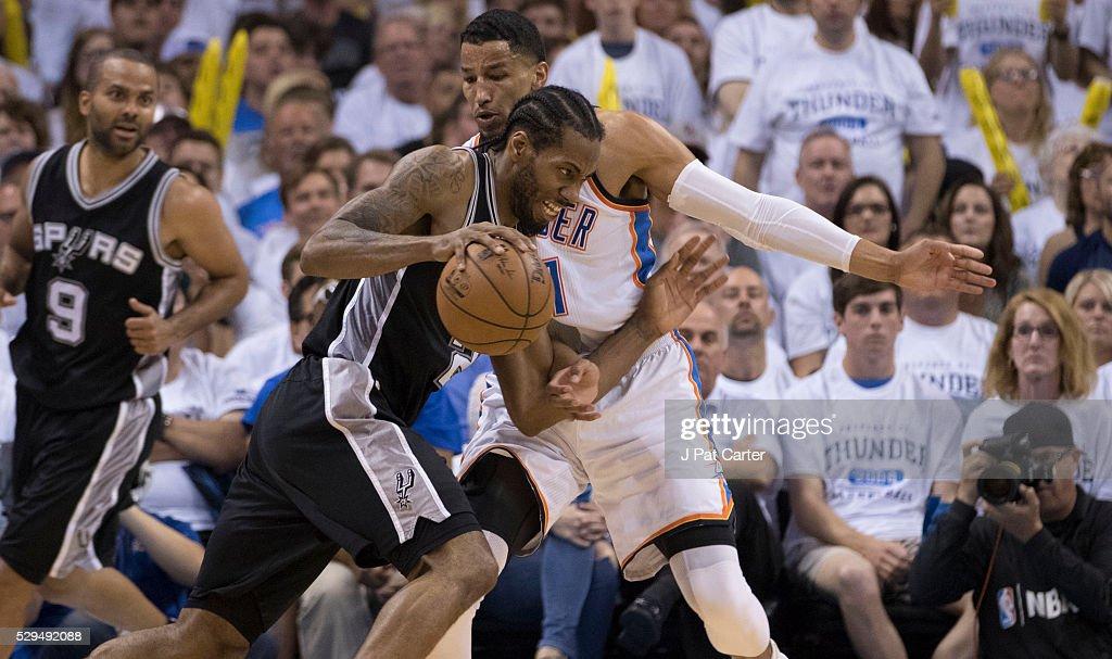 f715b2a965ef Kawhi Leonard of the San Antonio Spurs tries to drive around Andre ...