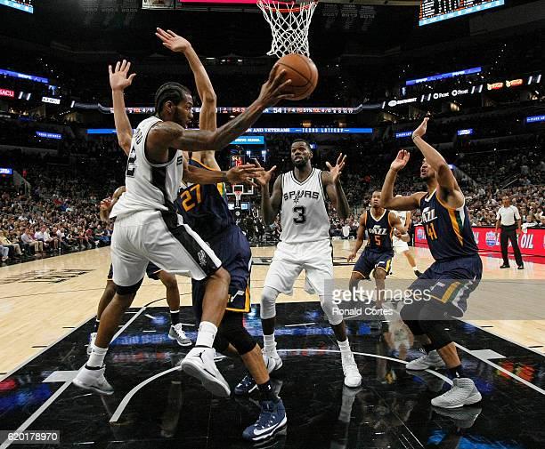 Kawhi Leonard of the San Antonio Spurs tries to pass the ball to teammate Dewayne Dedmon of the San Antonio Spurs during game between Utah Jazz and...