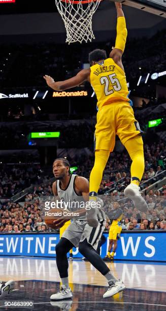 Kawhi Leonard of the San Antonio Spurs waits for Malik Beasley of the Denver Nuggets to fly by before he shoots at ATT Center on January 13 2018 in...