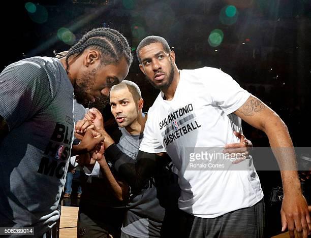 Kawhi Leonard of the San Antonio SpursTony Parker of the San Antonio Spurs and LaMarcus Aldridge of the San Antonio Spurs huddle before their game...