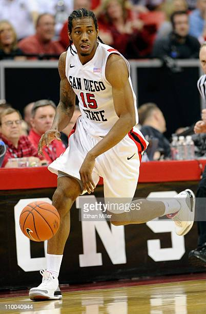 Kawhi Leonard of the San Diego State Aztecs brings the ball up the court during a quarterfinal game of the Conoco Mountain West Conference Basketball...