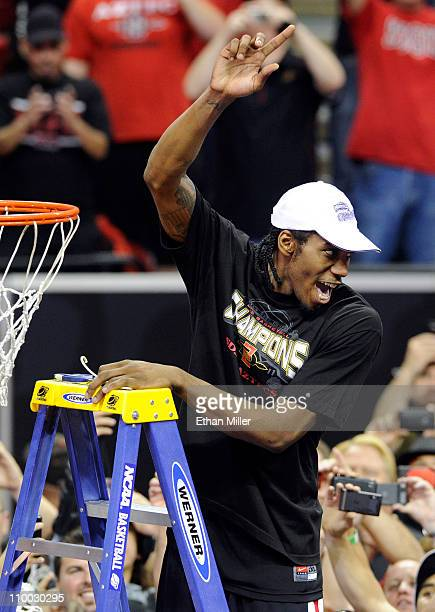 Kawhi Leonard of the San Diego State Aztecs celebrates as he cuts a net after the team's 7254 victory over the Brigham Young University Cougars in...