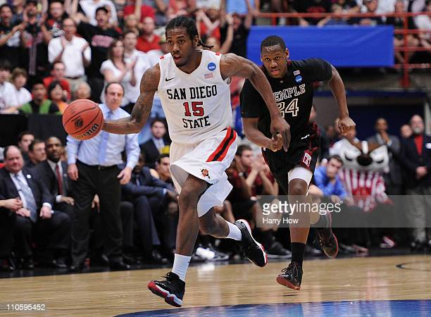 Kawhi Leonard of the San Diego State Aztecs drives against the Temple Owls during the third round of the 2011 NCAA men's basketball tournament at...