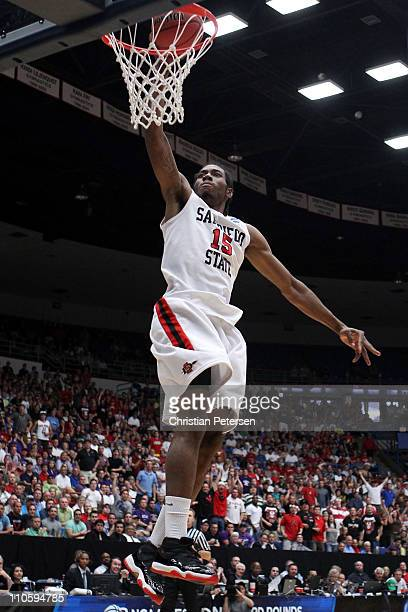 Kawhi Leonard of the San Diego State Aztecs dunks against the Temple Owls during the third round of the 2011 NCAA men's basketball tournament at...