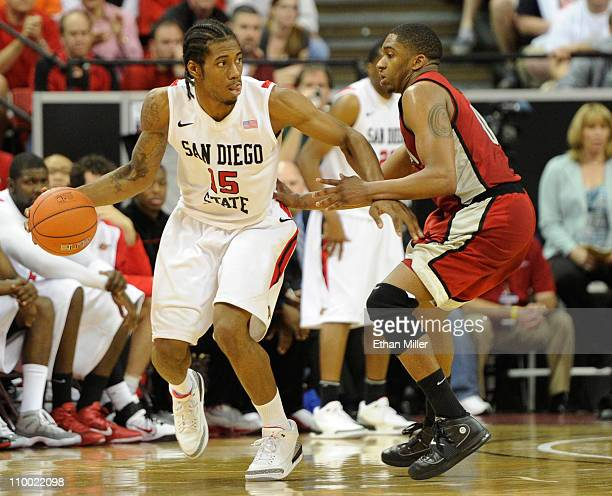 Kawhi Leonard of the San Diego State Aztecs is guarded by Oscar Bellfield of the UNLV Rebels during a semifinal game of the Conoco Mountain West...