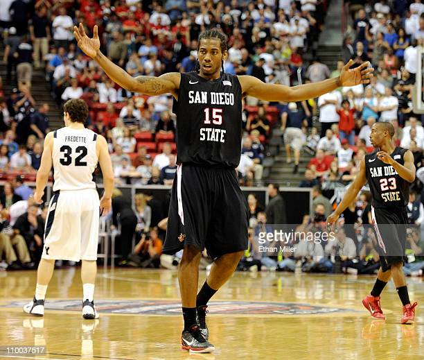 Kawhi Leonard of the San Diego State Aztecs raises his arms in the last few seconds of the team's 7254 victory over the Brigham Young University...