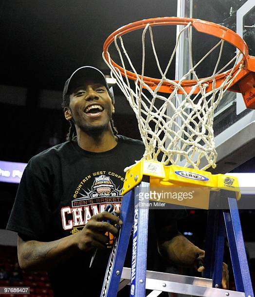 Kawhi Leonard of the San Diego State Aztecs smiles as he gets ready to cut down the net after defeating the UNLV Rebels 5545 in the championship game...