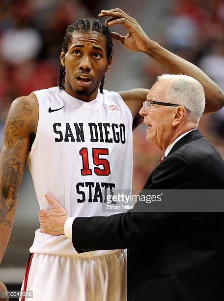 Kawhi Leonard of the San Diego State Aztecs talks to head coach Steve Fisher during the team's 6450 victory over the Utah Utes in a quarterfinal game...