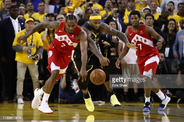 Kawhi Leonard of the Toronto Raptors and DeMarcus Cousins of the Golden State Warriors battle for the ball late in the game during Game Six of the...