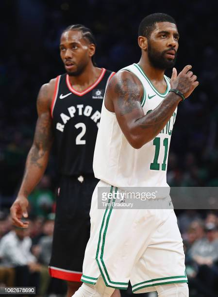 Kawhi Leonard of the Toronto Raptors and Kyrie Irving of the Boston Celtics look on during the first half at TD Garden on November 16 2018 in Boston...