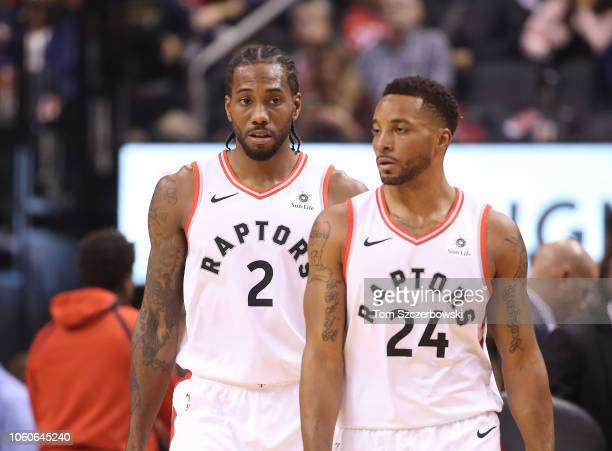 Kawhi Leonard of the Toronto Raptors and Norman Powell during their NBA game against the Dallas Mavericks at Scotiabank Arena on October 26 2018 in...