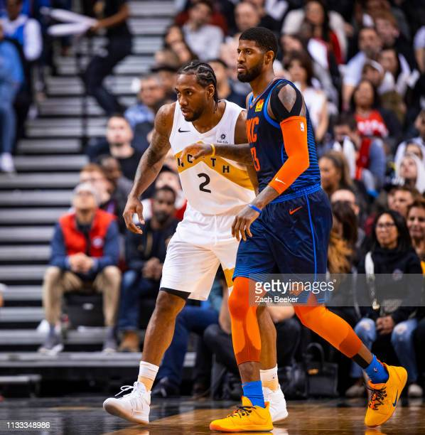 Kawhi Leonard of the Toronto Raptors and Paul George of the Oklahoma City Thunder defend their positions during the game on March 22 2019 at...
