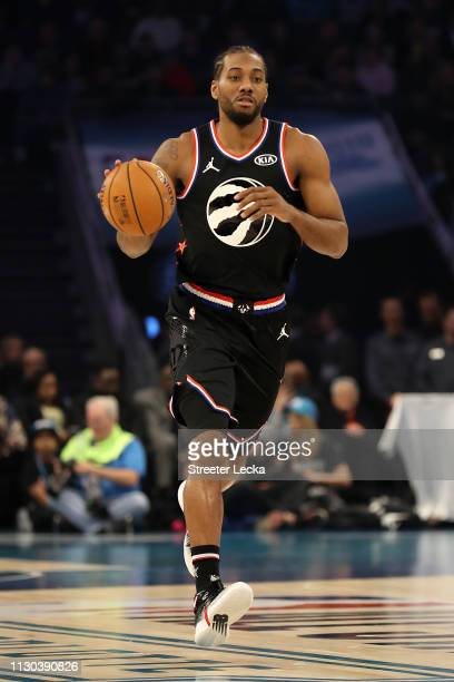 Kawhi Leonard of the Toronto Raptors and Team LeBron drives the ball against Team Giannis in the first quarter during the NBA AllStar game as part of...