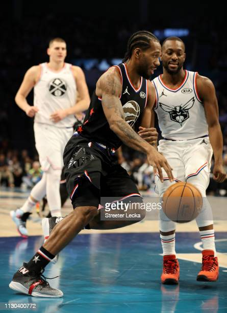 Kawhi Leonard of the Toronto Raptors and Team LeBron drives to the basket against Team Giannis in the first quarter during the NBA AllStar game as...