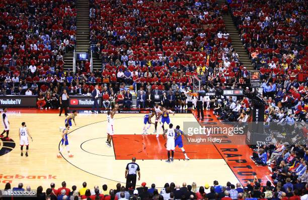 Kawhi Leonard of the Toronto Raptors attempts a free throw against the Golden State Warriors in the second half during Game Two of the 2019 NBA...
