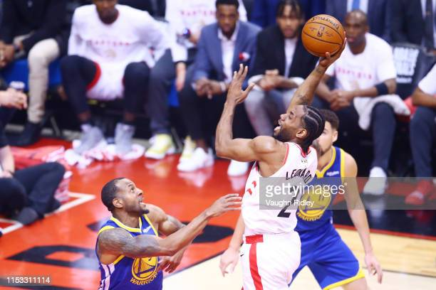 Kawhi Leonard of the Toronto Raptors attempts a shot against the Golden State Warriors in the first half during Game Two of the 2019 NBA Finals at...