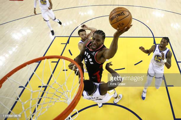 Kawhi Leonard of the Toronto Raptors attempts a shot against the Golden State Warriors during Game Three of the 2019 NBA Finals at ORACLE Arena on...