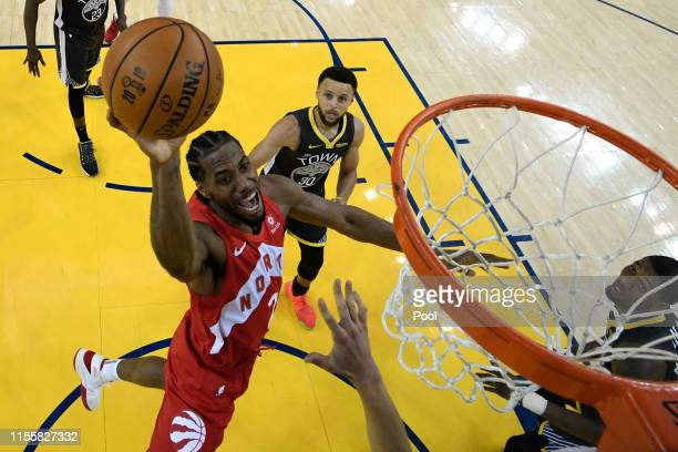 Kawhi Leonard of the Toronto Raptors attempts a shot against the Golden State Warriors during Game Six of the 2019 NBA Finals at ORACLE Arena on June...