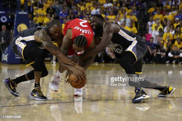Kawhi Leonard of the Toronto Raptors battles for the ball with Andre Iguodala and Draymond Green of the Golden State Warriors in the second half...
