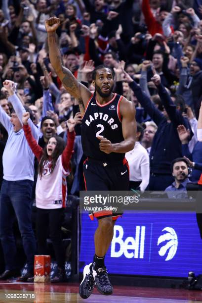 Kawhi Leonard of the Toronto Raptors celebrates scoring the winning basket during the second half of an NBA game against the Brooklyn Nets at...