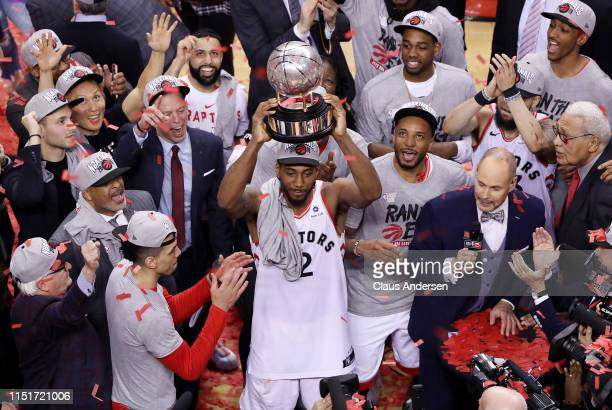 Kawhi Leonard of the Toronto Raptors celebrates with the Eastern Conference Finals trophy after defeating the Milwaukee Bucks 10094 in game six of...
