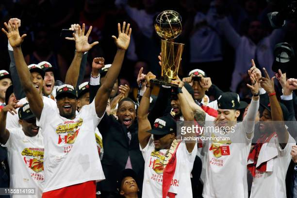 Kawhi Leonard of the Toronto Raptors celebrates with the Larry O'Brien Championship Trophy after his team defeated the Golden State Warriors to win...