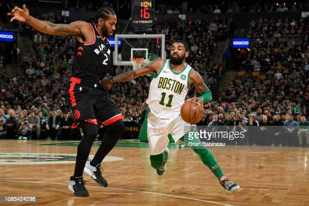 Kawhi Leonard of the Toronto Raptors defends against Kyrie Irving of the Boston Celtics on January 16 2019 at the TD Garden in Boston Massachusetts...
