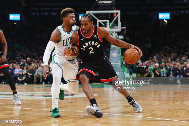 Kawhi Leonard of the Toronto Raptors dribbles against Marcus Smart of the Boston Celtics during the first half at TD Garden on November 16 2018 in...